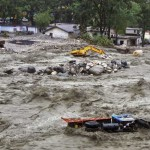 bulldozer-and-other-vehicles-are-drifted-in-a-flooded-river-in-uttarkashi-district