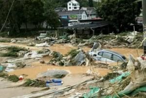 Car and flood debris. Photo Credit FMT