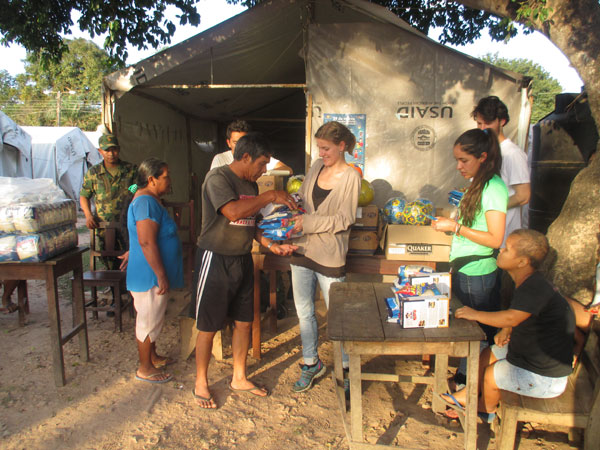 Distributing supplies in one of the refugee camps, Beni. Photo: Mariel Cabero Ugalde
