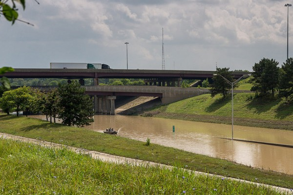 FLooded Highways, Royal Oak, Michigan. The flooded interchange of I-75 / I-696. complete with rescue boat. Photo 12 August 2014, https://www.flickr.com/photos/bgilbow/