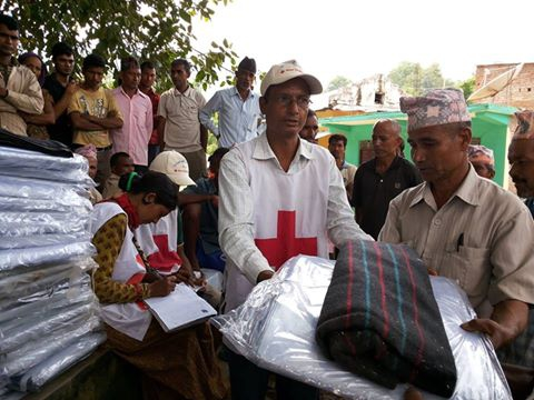 Nepal Red Cross volunteers distributing non-food relief items to flood affected families in Dang District , Nepal. Photo: IFRC / NRCS