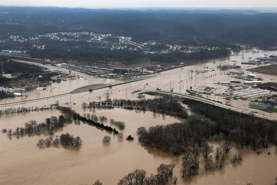 The Effects Of Flooding In Pacific Mo Are Visible From A Missouri National Guard UH 60 Black Hawk Helicopter Carrying Gov Jay Nixon Army Maj
