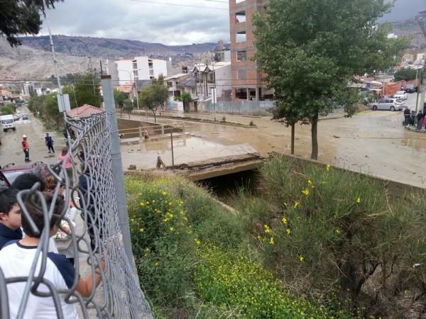 Bridge topped by the flash flood in La Paz, Bolivia. Photo courtesy of Andrea Innocenti