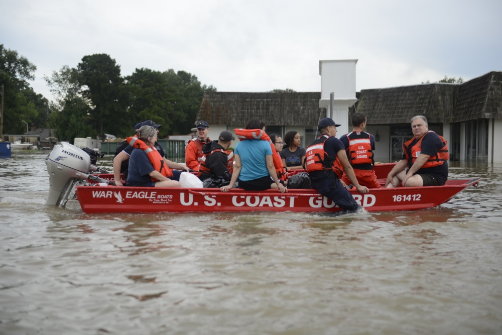 U.S. Coast Guard members rescue locals from flood water on their flat-bottom boats in Baton Rouge, Louisiana, Aug. 14, 2016. U.S. Coast Guard photo by Petty Officer 3rd Class Brandon Giles