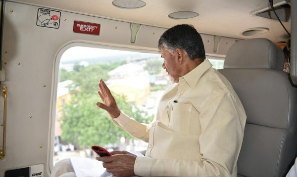 Andhra Pradesh Chief Minister undertakes an aerial survey of flood hit Guntur. Photo: Office of the Chief Minister