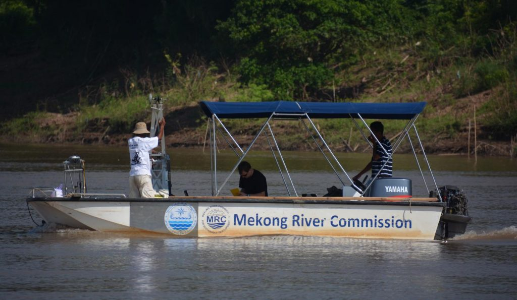 Researchers on Mekong River Commission boat. Credit:  University of