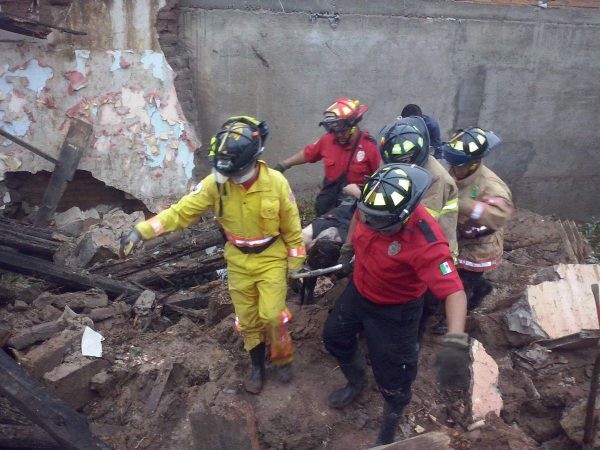 Civil Protection workers searching a collapsed house after floods in Durango, 29 to 30 September, 2016. Photo: Government of Durango