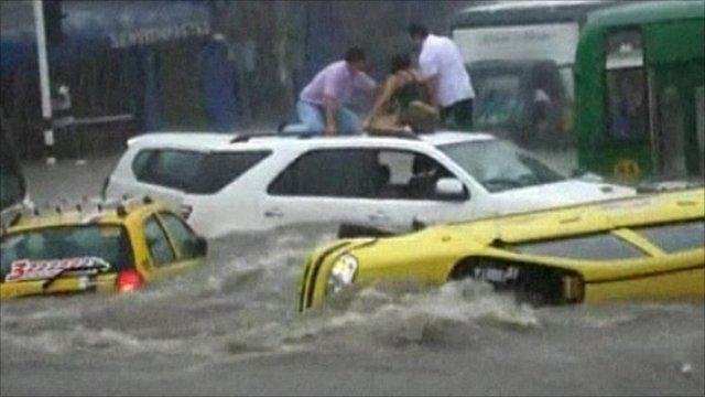 Cars in a flooded street Colombia