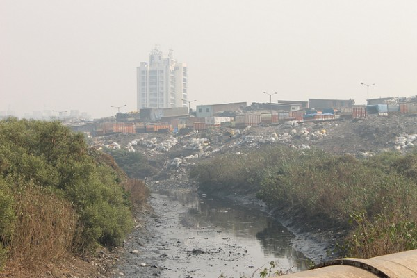 Dredges of Dharavi's recycling industry overflowing onto the banks of the river, 2012. Photo: bmw guggenheimlab @ flickr