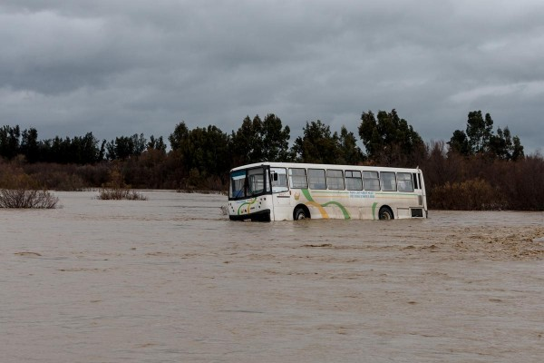 JENDOUBA, TUNISIA - FEBRUARY 28: A bus is seen in the flood water caused by heavy rainfall in the Bu Salim district of Jendouba City of Tunisia on February 28, 2015.  Photo: AA