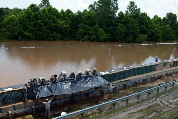 Louisiana National Guardsmen work to reinforce a temporary wall constructed to hold back water that overtopped a floodwall near the Clyde Fant Parkway and Jimmy Davis Highway in Shreveport, La., June 8, 2015. (U.S. Army National Guard photo by Spc. Joshua Barnett, Louisiana National Guard Public Affairs Office/Released)