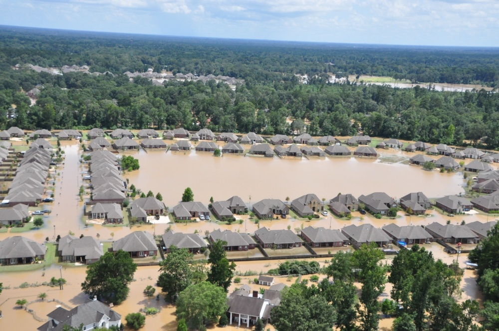 Flooded areas of Baton Rouge, Louisiana, are shown Aug. 15, 2016. To date, Coast Guard crews have rescued more than 195 people, assisted more than 2,902 people in distress and rescued 26 pets. U.S. Coast Guard photo by Petty Officer 1st Class Melissa Leake