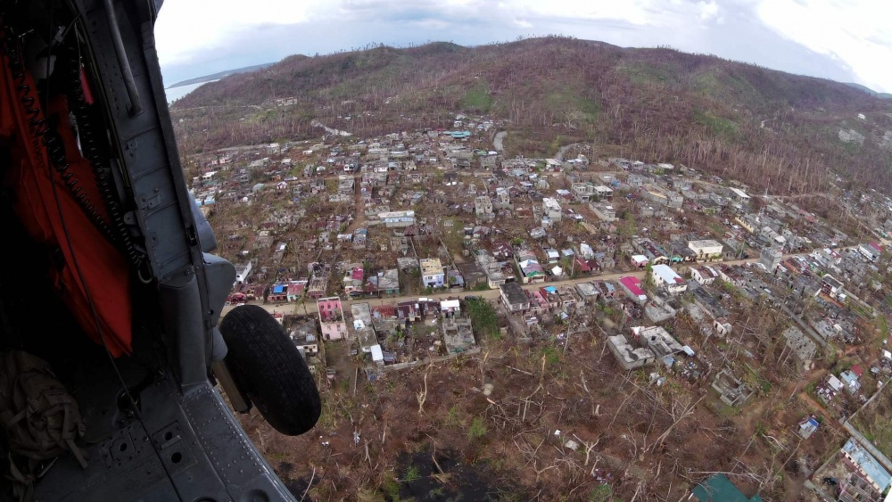 A Helicopter Sea Combat Squadron 28 (HSC-28 ) pilot looks down at the aftermath of Hurricane Matthew from an MH-60S Seahawk. USS Iwo Jima (LHD 7) and the 24th Marine Expeditionary Unit are providing disaster relief and humanitarian aid to Haiti following Hurricane Matthew. (U.S. Navy photo by Chief Petty Officer Christopher Adams)