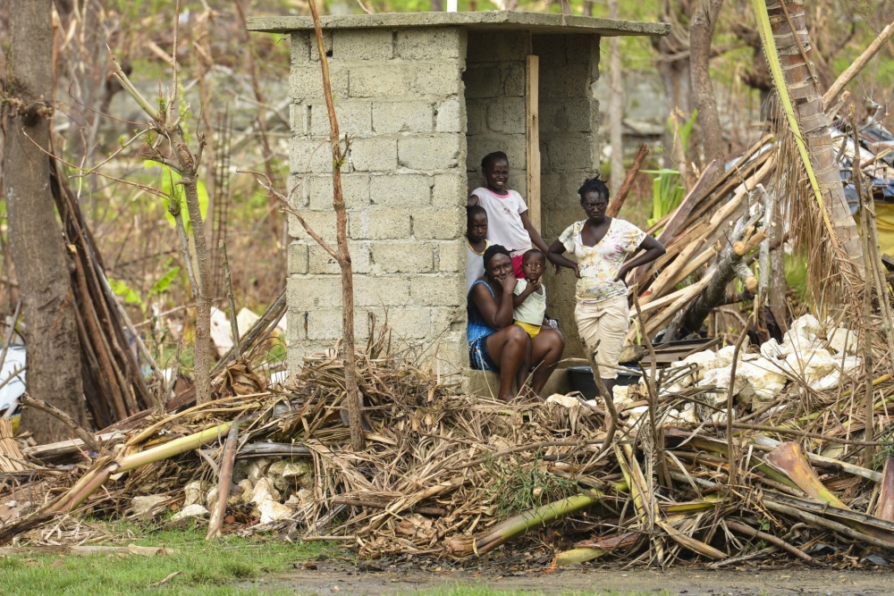 Locals of Anse-d'Hainault stand by as supplies are delivered by Sailors and Marines attached to Joint Task Force Matthew. JTF Matthew is providing humanitarian aid and disaster relief to Haiti following Hurricane Matthew. (U.S. Navy photo by Petty Officer 3rd Class Gary J. Ward)